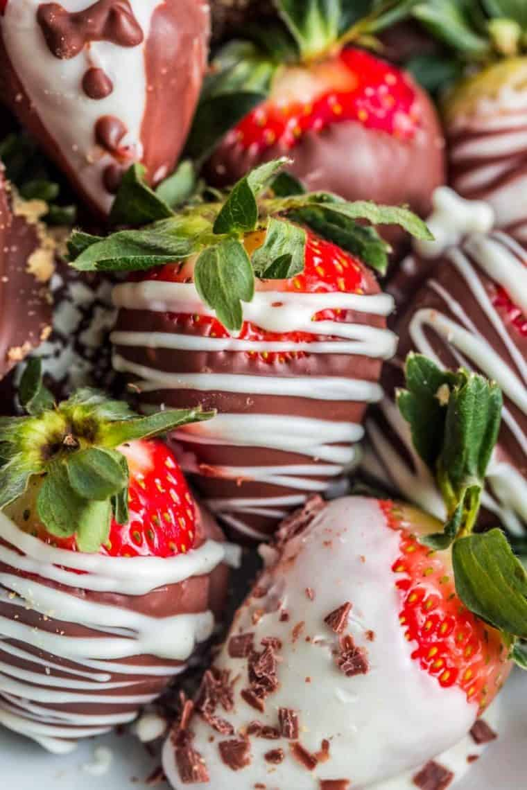Chocolate covered strawberries drizzled with white chocolate and chocolate shavings.
