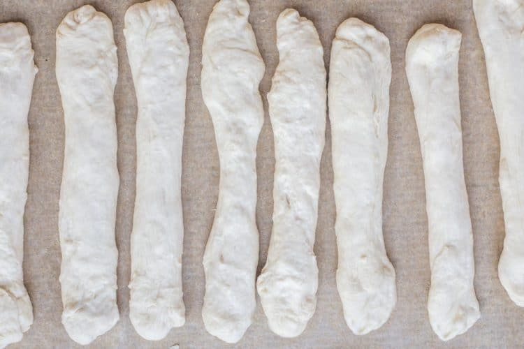 How to make twelve homemade bread sticks from scratch.