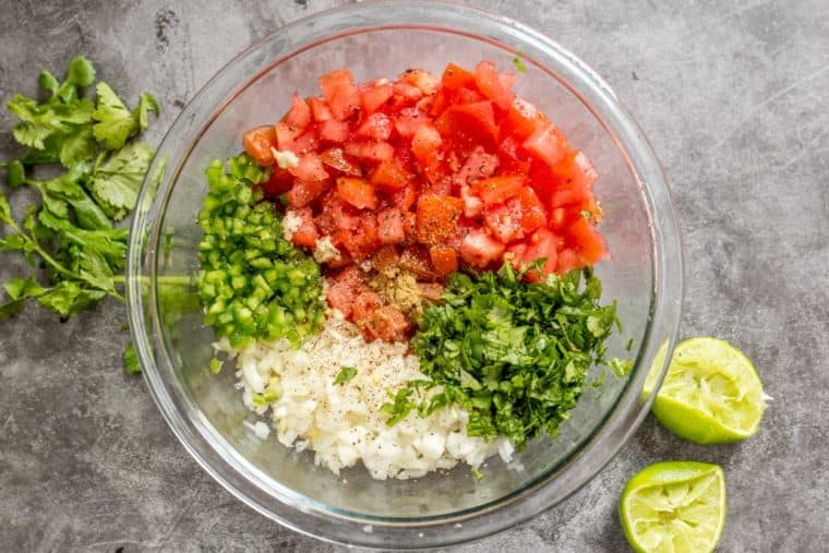 How to make the classic pico de gallo salsa recipe with tomatoes, cilantro, onions and jalapenos.