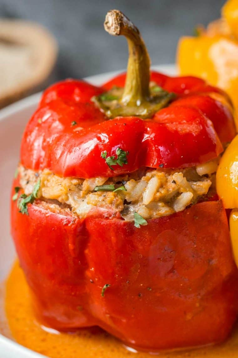 Red bell pepper stuffed with beef rice filling chopped with chopped greens.