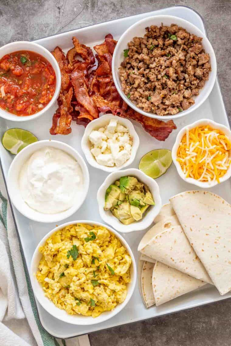 All the breakfast taco ingredients on a tray.