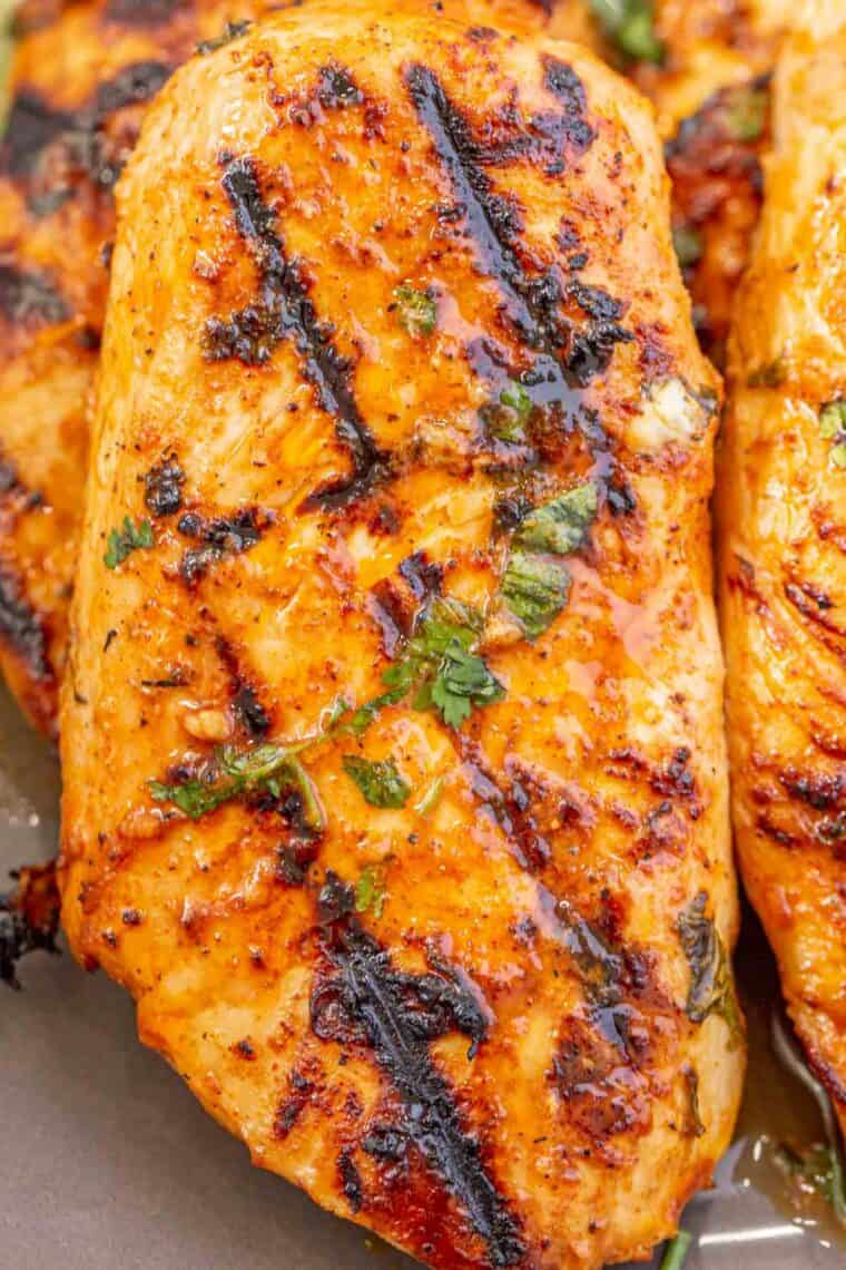 Tender and juicy chicken breast loaded with flavors topped with cilantro and lime slices.