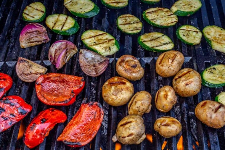Zucchini, red pepper, red onion, and mushrooms on the grill.