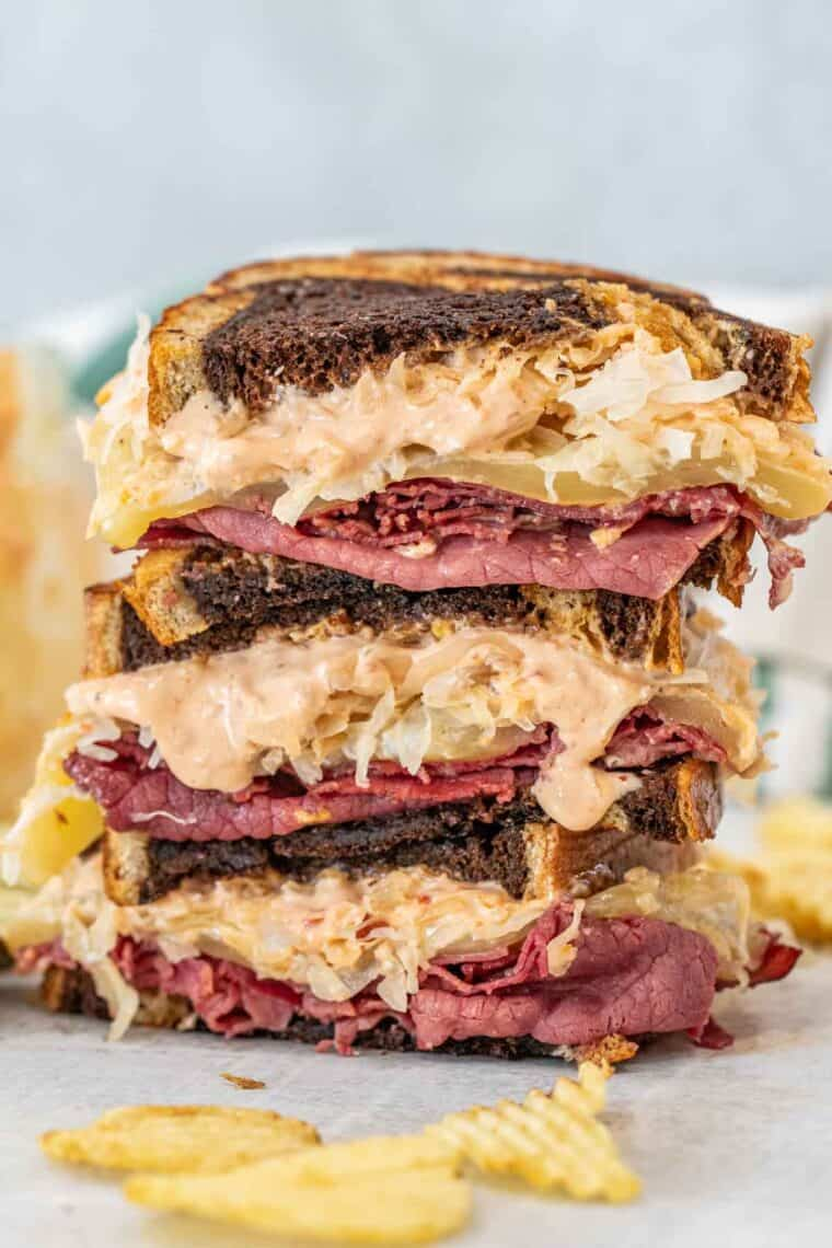 Homemade Reuben sandwich stacked on top of each other loaded with flavors.