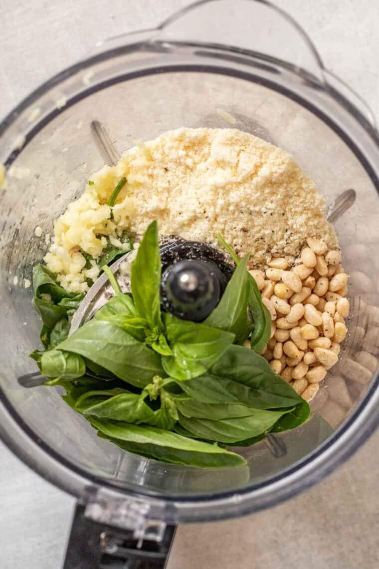 Basil pesto ingredients in a blender.